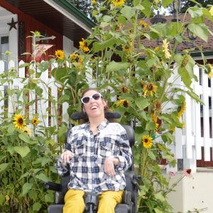 Bree Robertson with giant sunflowers