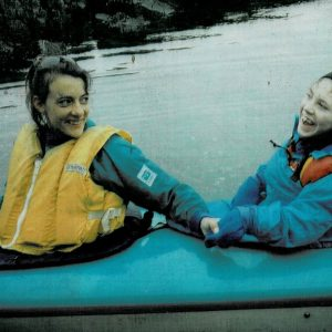A woman with a disability and her sister kayaking